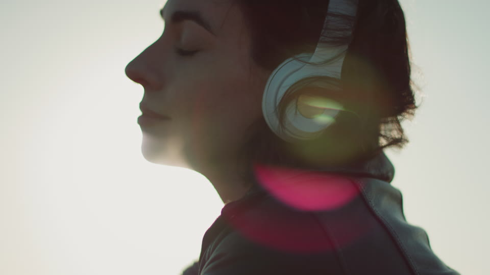 Get 5K premium stock footage video clip - Woman putting headphones on  - shot on RED Camera. Available immediately in RED R3D format. Choose from a wide range of footage collections with clips that belong together. One simple license for any use. New collections added weekly. ID 1850. Download footage now!