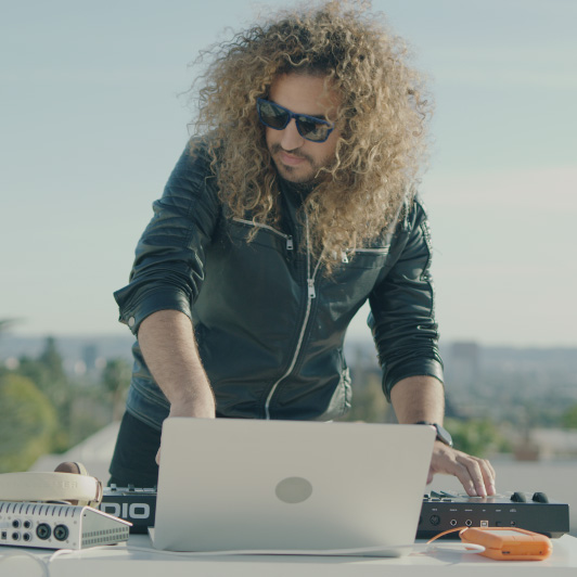 8K premium royalty-free stock footage shot on RED Camera, instantly available in RED R3D format. License this collection of DJ On The Rooftop now!