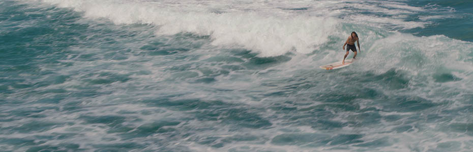 Cinematic Stock Footage Of A Skilled Surfer In The Beautiful Hawaiian Scenery