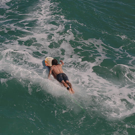 8K premium royalty-free stock footage shot on RED Camera, instantly available in RED R3D format. License this collection of Hawaiian Surfer now!