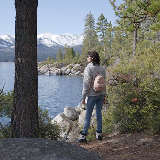 8K premium royalty-free stock footage shot on RED Camera, instantly available in RED R3D format. License this collection of Woman Hiking on Rocky Lake Shore now!