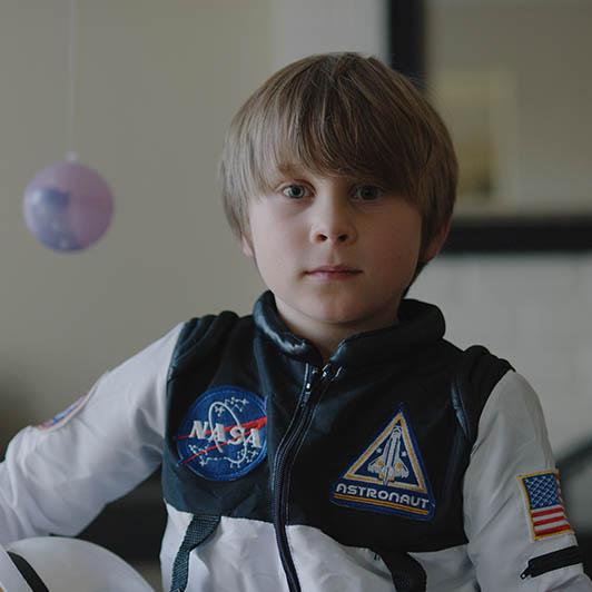 8K premium royalty-free stock footage shot on RED Camera, instantly available in RED R3D format. License this collection of Young Astronaut now!
