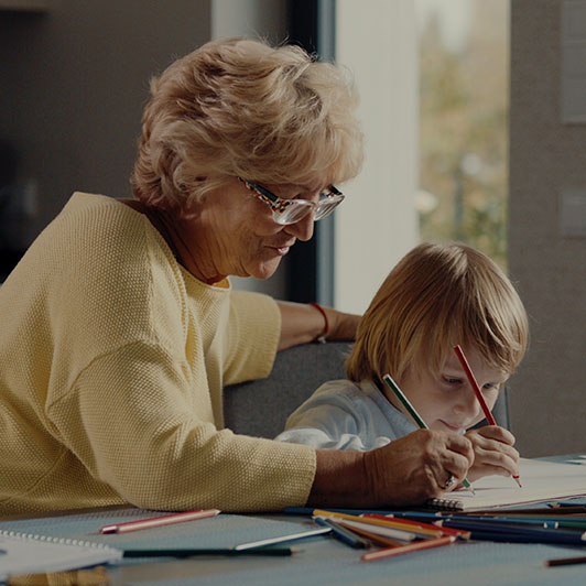 8K premium royalty-free stock footage shot on RED Camera, instantly available in RED R3D format. License this collection of Grandmother Draws With Her Grandson now!