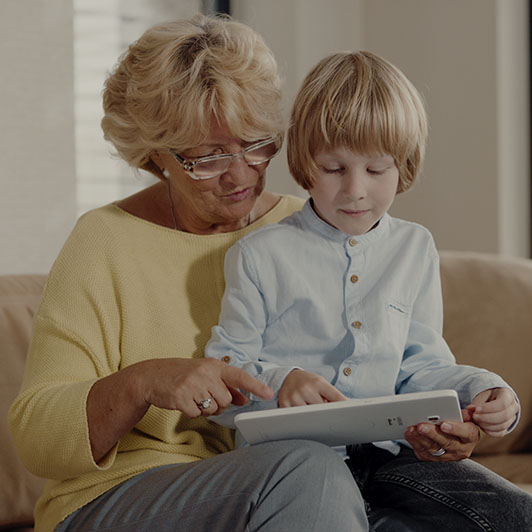 8K premium royalty-free stock footage shot on RED Camera, instantly available in RED R3D format. License this collection of Grandmother Plays On Tablet With Her Grandson now!